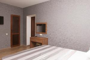 A bed or beds in a room at Hotel Chernomorsky Complex of Townhouse