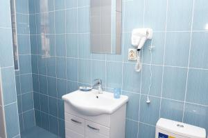 A bathroom at Hotel Chernomorsky Complex of Townhouse