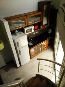 A kitchen or kitchenette at Piedras Suites