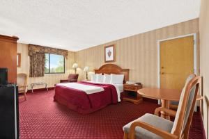 A bed or beds in a room at Oh St Joseph Resort Hotel