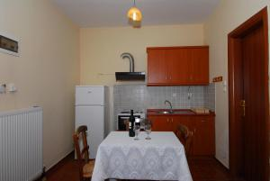 A kitchen or kitchenette at Menelaos Apartments