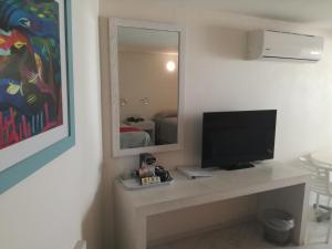 A television and/or entertainment center at We Hotel Acapulco