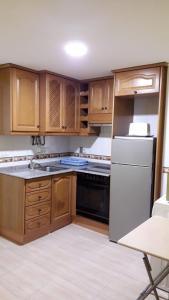 A kitchen or kitchenette at Oropesa del Mar I