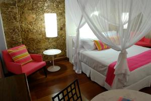 A bed or beds in a room at Casa Turquesa - Maison D´Hôtes