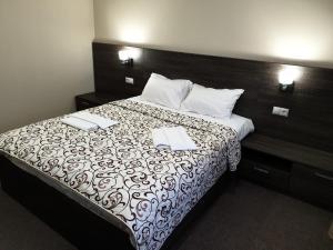 Кровать или кровати в номере Зуль Отель