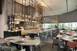 A restaurant or other place to eat at Capri by Fraser Johor Bahru