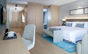 A bed or beds in a room at Fraser Residence Kuala Lumpur