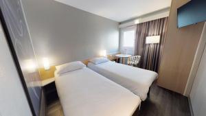 Un ou plusieurs lits dans un hébergement de l'établissement ibis Thonon Centre