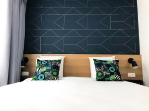 Letto o letti in una camera di Hygge Hotel