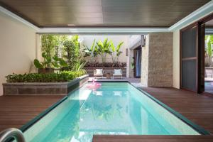 The swimming pool at or near HaitangBay Loosen Coast Resort Villas