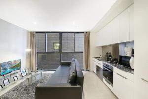 A kitchen or kitchenette at A Central 2BR Apt Near Bourke St Mall & Chinatown
