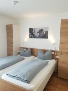 Ein Bett oder Betten in einem Zimmer der Unterkunft easy sleep Apartmenthotel