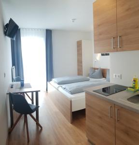 Küche/Küchenzeile in der Unterkunft easy sleep Apartmenthotel