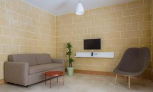 A seating area at Mellieha Holiday Centre
