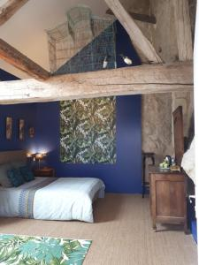 A bed or beds in a room at Beaulieu La Source