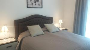 A bed or beds in a room at Villa Giada