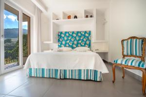 A bed or beds in a room at Casa Evelina Sorrento
