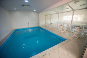 The swimming pool at or near Hotel Castelo