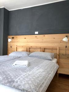 Postelja oz. postelje v sobi nastanitve Hisa Rejmr