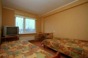 A television and/or entertainment center at Hotel Talsi