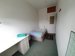 Кровать или кровати в номере Uenuku Lodge