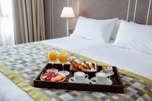 Una cama o camas en una habitación de Hotel Spa Republica