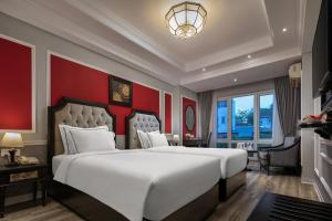A bed or beds in a room at Acoustic Hotel & Spa
