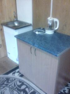 A kitchen or kitchenette at Дом на два номера
