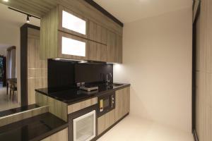 A kitchen or kitchenette at Matahari Bungalow