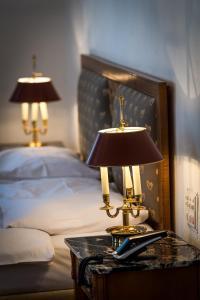 Ein Bett oder Betten in einem Zimmer der Unterkunft Auberge du Raisin