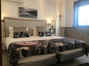 A bed or beds in a room at The Birds Nest Luxury B&B