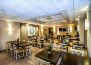 Restaurant ou autre lieu de restauration dans l'établissement SM Hotel Teatre Auditori