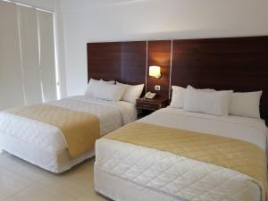Cama o camas de una habitación en Prince Hotel