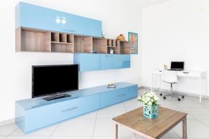 Télévision ou salle de divertissement dans l'établissement Airport Capodichino Napoli Flat