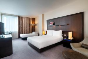 A bed or beds in a room at Hilton London Canary Wharf
