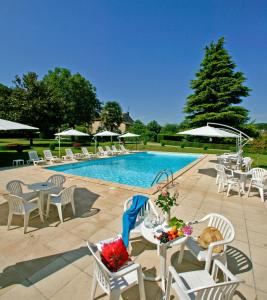 The swimming pool at or near Hôtel des Roches