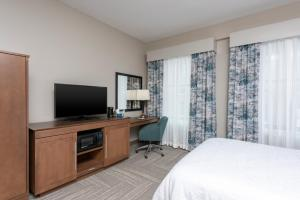 A television and/or entertainment center at Hampton Inn Indianapolis Downtown Across from Circle Centre