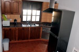 A kitchen or kitchenette at Mama Yé