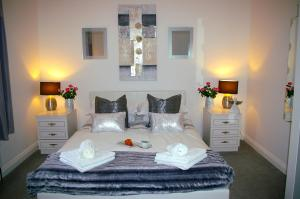 A bed or beds in a room at Humberstone House