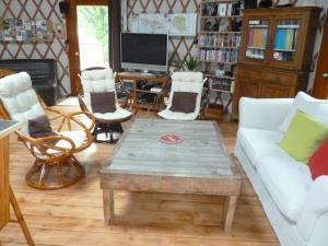 A seating area at les Yourtes du Perche