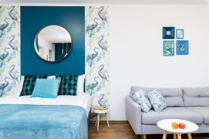 A bed or beds in a room at Sleepway Apartments - Blue Dream