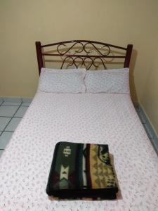 A bed or beds in a room at Depa facil acceso Aeropuerto, Metro, Bosque Aragon