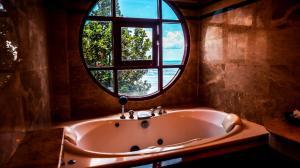 Ein Badezimmer in der Unterkunft Mac Resort Hotel