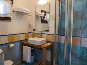 Kúpeľňa v ubytovaní Hotel Cala Reale