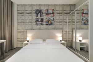 A bed or beds in a room at Downtown Boutique Hostel