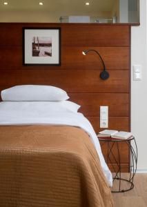 A bed or beds in a room at Seehotel Europa
