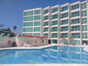 The swimming pool at or near We Hotel Acapulco