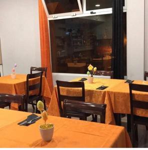 Restaurant ou autre lieu de restauration dans l'établissement Alojamento Local Atlântico