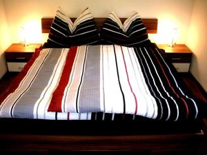 A bed or beds in a room at Easyapartments Countryside