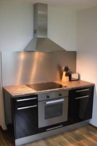 A kitchen or kitchenette at Easyapartments Countryside